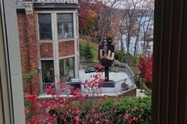 06-man-erects-middle-finger-statue