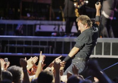 20080727TK  8/x  Bruce Springsteen reaches out into the crowd as he performs with the E-Street Band at Giants Stadium this evening. EAST RUTHERFORD, NJ  7/27/08  8:42:01 PM  TONY KURDZUK/THE STAR-LEDGER