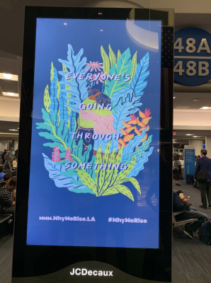 01-Airport-Everyones-going-through-something-sign