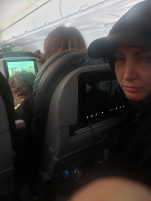 02-Gina-on-Airplane-with-Seat-Reclining